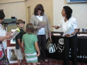 Inspirational Speaker Myra Goldick speaks to attendees at VSA Arts event